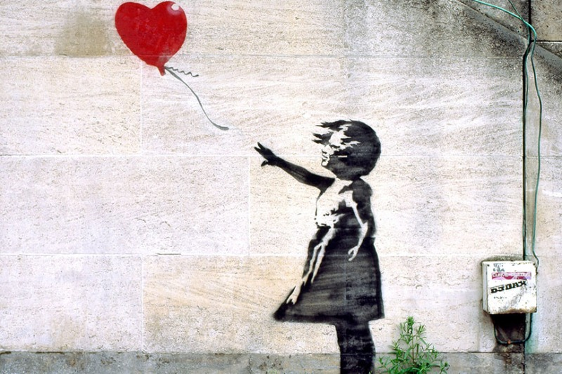 Banksy's-Girl-with-Balloon-on-a-South-Bank-wall-near-the-National-Theatre-in-2004.-Photograph-Alamy.jpg